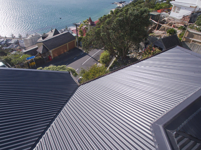 A shot from on top of a dark metal roof looking out onto the ocean.